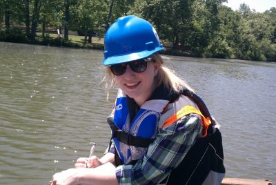 Undergraduate Chelsea Delsack preparing to sample Dan River in Danville