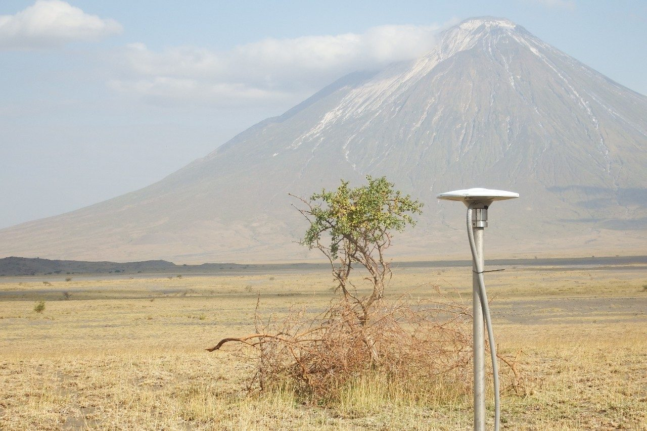 GPS site with volcano in background